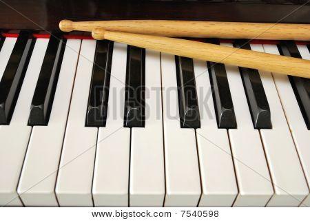 Drum Sticks On Piano Keyboard