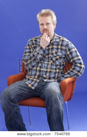 Man Thinking On A Chair
