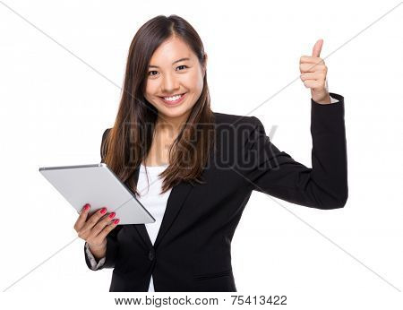 Singaporean businesswoman use tablet and thumb up