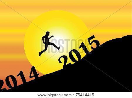 A Young Man Silhouette Jumping Past 2014 Into The New Year 2015 On Mountain With Bright Yellow Sun