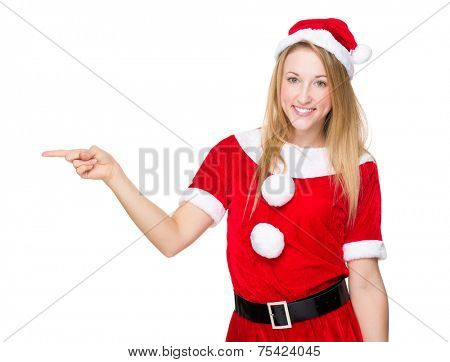 Christmas woman with finger point aside