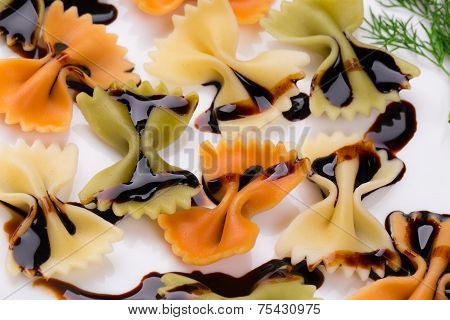 Bow tie pasta with soy sauce.