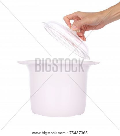 Hand hold glass cover of ceramic steam pot on white background.