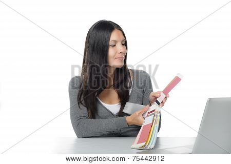 Young Woman Comparing Colors Online