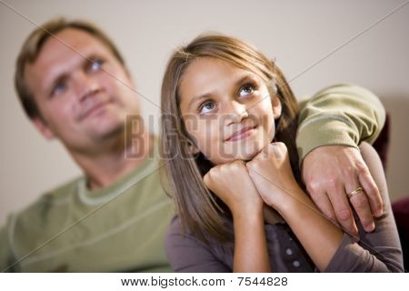 Ten Year Old Girl Sitting Beside Father