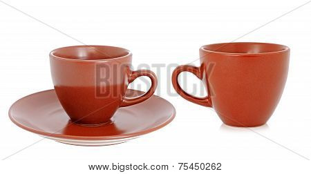 Brown Cup And Saucer On The White Background
