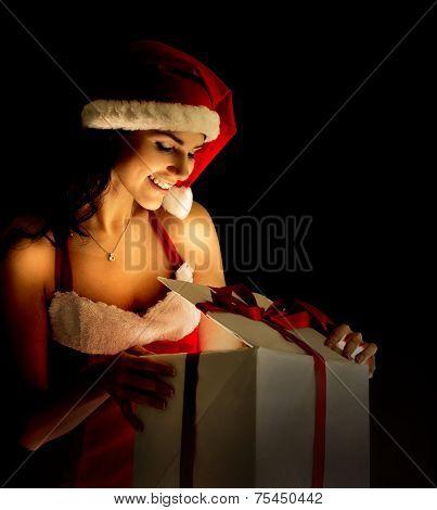 santa woman opening the magical Christmas present box
