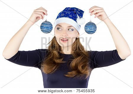 Portrait of young woman looking at christmas balls
