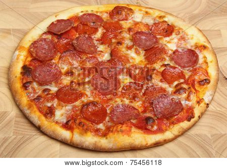 Pepperoni pizza on wooden serving board