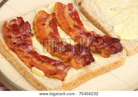 Bacon sandwich being made with wholewheat bread