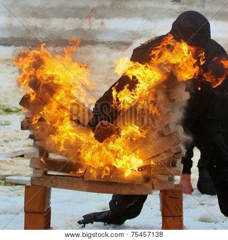 Man Breaks Bricks In The Fire