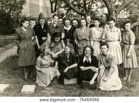 LODZ, POLAND, CIRCA FIFTIES: Vintage photo of group of female schoolmates