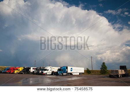 Typical American Trucks On A Parking Place Before Heavy Storm In Wyoming