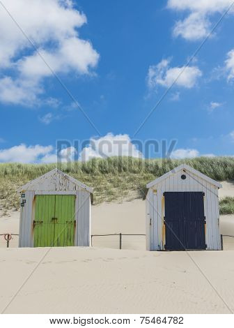 Two Cabins Or Huts On The Beach