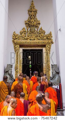 Buddhist monks enter Wat Pho