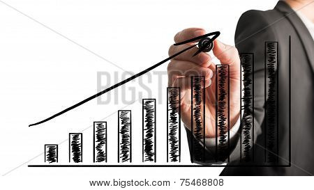 Businessman Drawing An Ascending Bar Graph