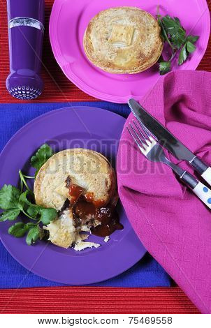 Modern Colorful Casual Lunch Table Place Setting With Beef Meat Pies And Sauce With Bright Colorful
