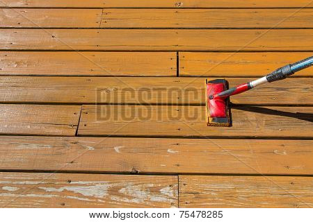 Wood Stain With A Paint Pad  On Wooden Patio Floor