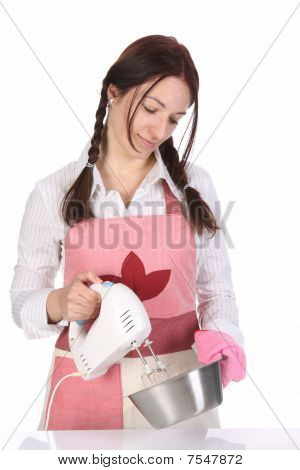 Beautiful Housewife Preparing With Kitchen Mixer