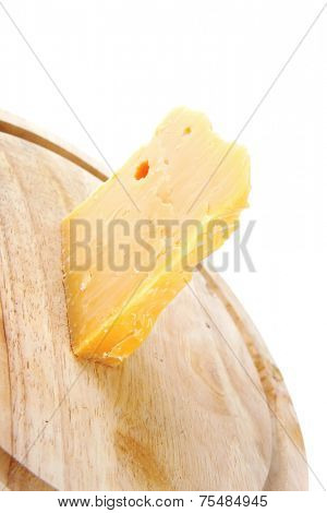 fresh piece of edam cheese on wooden board