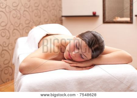 Woman Ready For Massage In A Spa Setting