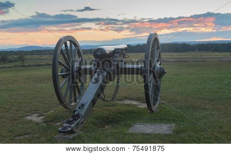 Union artillery looking over a field at Gettysburg.