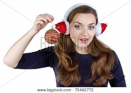 Photo of woman in winter headphones with ball