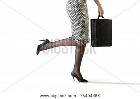Close up of business woman wearing heels and carrying an attache case