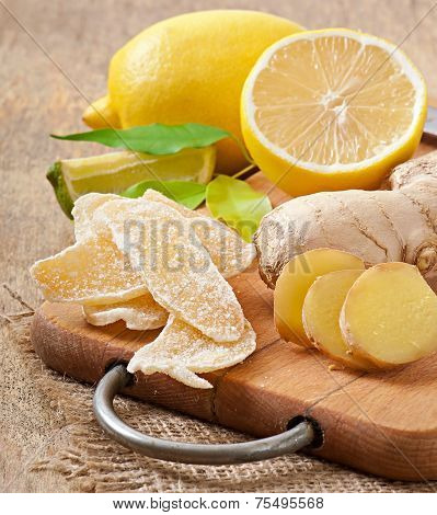 Fresh ginger root, candied ginger and lemon