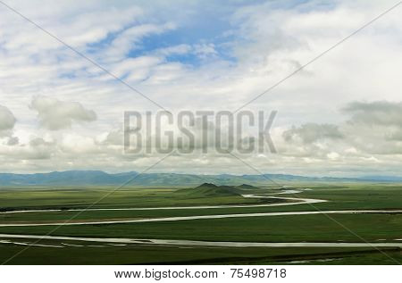 landscape of cloudy sky and vast steppe