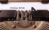 stock photo of typewriter  - Vintage inscription made by old typewriter coming soon - JPG