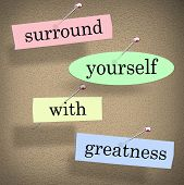 foto of saying  - Surround Yourself with Greatness words in a saying or quote pinned to a bulletin board for motivation and inspiration - JPG