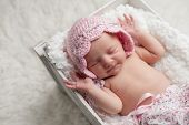 image of sleeping  - Portrait of a smiling seven day old newborn baby girl - JPG