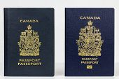stock photo of passport cover  - Close up of two valid Canadian passports the older issued prior to July 2013 and the new epassport issued November 2014 - JPG