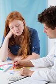 stock photo of gynecologist  - Gynecologist explaining young girl natural family planning - JPG
