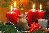 stock photo of fir  - Advent candles with fir green gift package and Christmas decoration - JPG