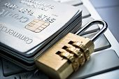 pic of debit card  - security lock on credit cards with computer keyboard  - JPG