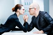 picture of angry man  - arm wrestling business woman VS business man - JPG