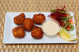 pic of conch  - Conch fritters served at the Caribbean island - JPG