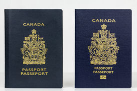 picture of passport cover  - Close up of two valid Canadian passports the older issued prior to July 2013 and the new epassport issued November 2014 - JPG