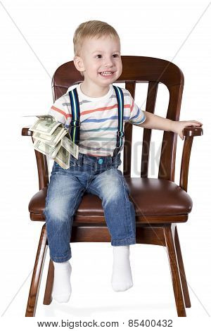 Boy Sitting In Chair And Holding Money
