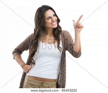 Beautiful brunette woman laughing and pointing to the left, isolated over white background