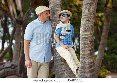 Happy father and son having rest outdoors
