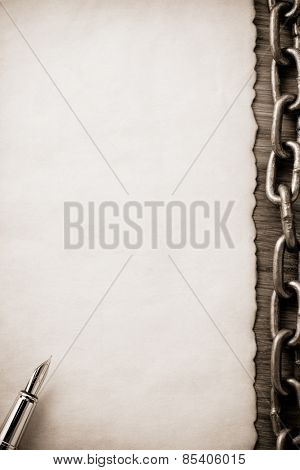 metal chain and old vintage ancient paper at wooden background
