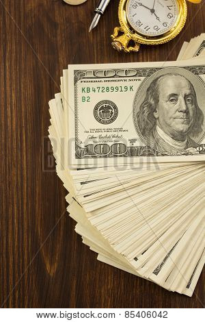 dollars money banknotes on wooden background