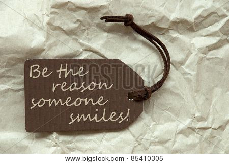 Brown Label With Quote Reason Someone Smiles Paper Background