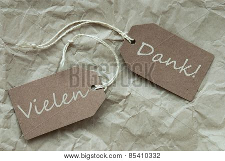 Two Beige Labels Vielen Dank Means Thank You Paper Background
