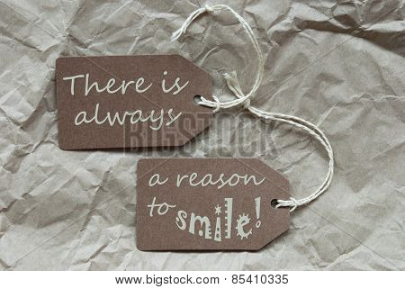 Two Brown Labels With Quote Always Reason Smile Paper Background