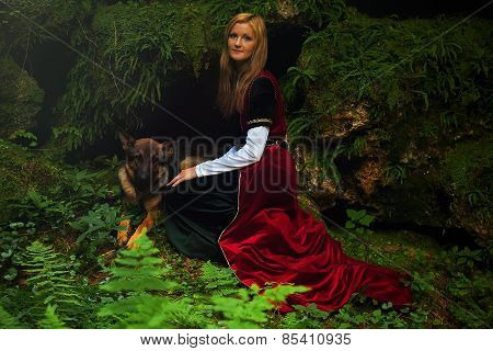 beautiful woman fairy with long blonde hair in a historical gown with dog