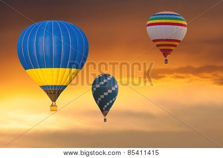 Few Hot Air Balloons in Flight on sunset sky background. Festival of colored balloons. Outdoor, Colo